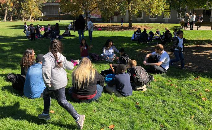 a group playing duck duck goose