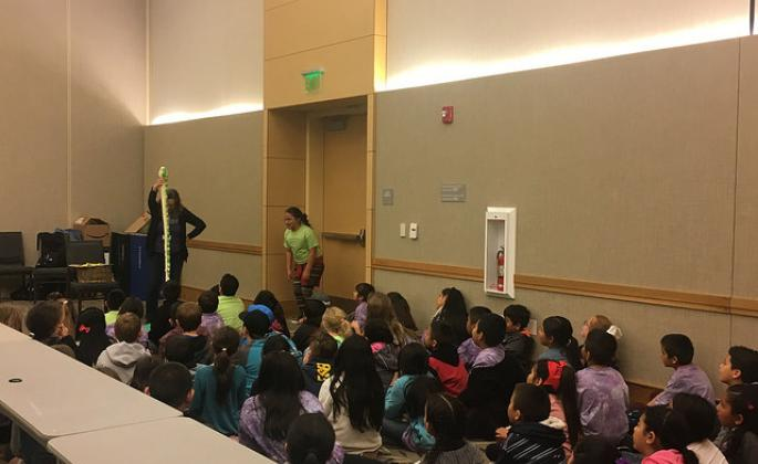 The kids interacting with storyteller, Laurie Cameron