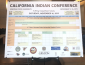 poster board with the schedule of the conference