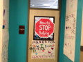 Students made colorful informative posters to educate the school about bullying.