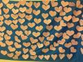 Paper hearts attached to a blue backdrop
