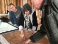 Dr. Margaret Purser pinpointing out what used to be two railroad systems in Santa Rosa map from 1886.